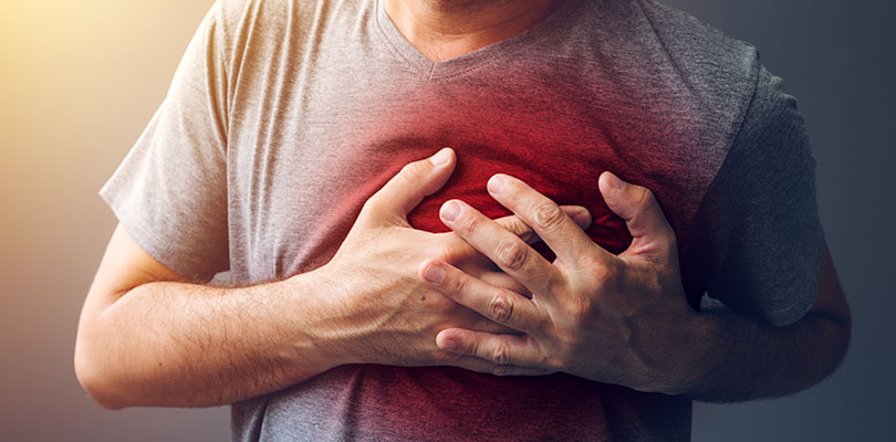 An individual is experiencing heartburn